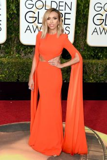 giuliana rancic stunning orange celebrity prom gown with cut outs at the sides at 2016 golden globes